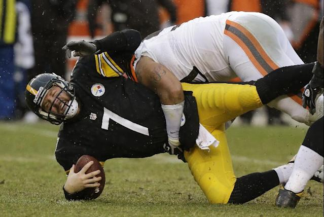 Pittsburgh Steelers quarterback Ben Roethlisberger (7) is sacked by Cleveland Browns defensive end Billy Winn (90) in the first quarter of an NFL football game in Pittsburgh, Sunday, Dec. 29, 2013. (AP Photo/Gene J. Puskar)