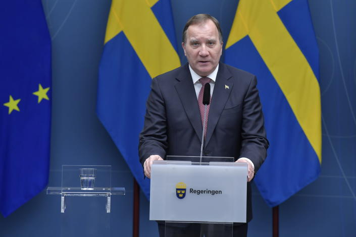 Sweden's Prime Minister Stefan Lofven speaks during a coronavirus news conference, in Stockholm, Friday, Dec. 18,2020. The Swedish government is tightening nationwide coronavirus restrictions by lowering the number of people who can gather in a restaurant and making face masks mandatory on public transportation. Sweden has stood out among European nations for its comparatively hands-off response to the pandemic. (Jessica Gow/TT News Agency via AP)