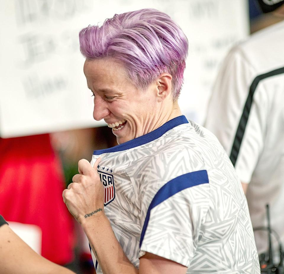 """<p>In the <strong>Harpers Bazaar</strong> interview, Rapinoe explained she has the word """"Mammers,"""" which is short for her mother's nickname, """"Mammer Jammers,"""" tattooed on the outside of her left wrist. """"And it's in Sue's handwriting, so that's kind of special too,"""" she said.</p>"""