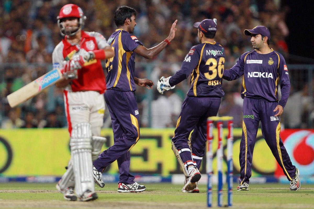 Gautam Gambhir and Manvinder Bisla congratulate Laksmipathy Balaji on taking the wicket of Manan Vohra during match 35 of the Pepsi Indian Premier League between The Kolkata Knight Riders and the Kings XI Punjab held at the Eden Gardens Stadium in Kolkata on the 26th April 2013. (BCCI)