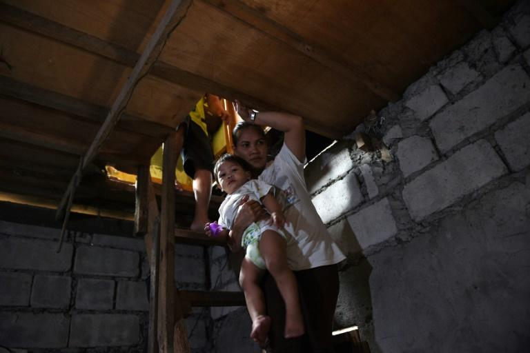Myrna Albos, 33, already had four children by the time a Philippine family planning law was passed in December 2012, but she had two more after opponents blocked it and the government health centre near her shanty ran out of birth control pills