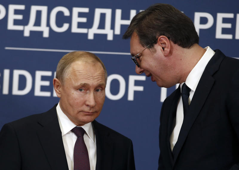 In this photo taken Thursday, Jan. 17, 2019, Russian President Vladimir Putin, left, speaks with Serbian President Aleksandar Vucic during a joint news conference in Belgrade, Serbia. Officials say on Monday, Aug. 26 Serbia will sign a free trade agreement with a Russian-led economic group, the move which could further hamper the Balkan country's proclaimed efforts to joining the European Union. (AP Photo/Darko Vojinovic)