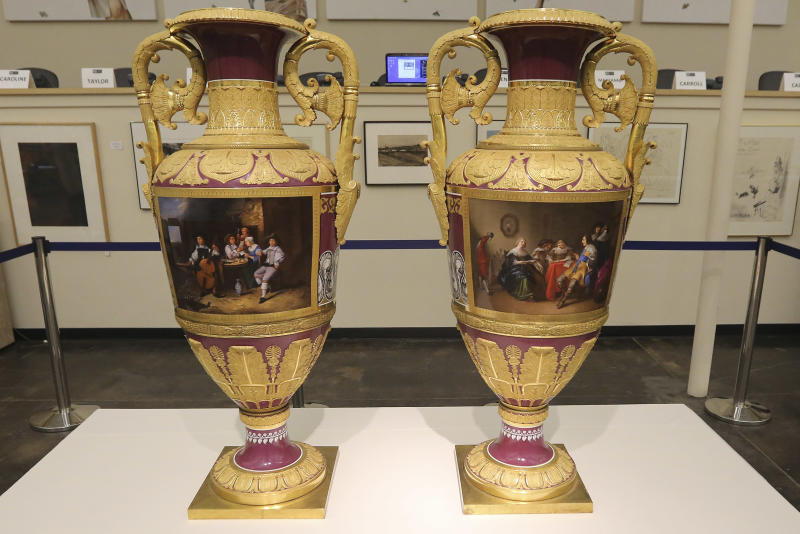 This photo made Thursday, April 4, 2013, shows rare Russian vases made in 1833 by Russia's Imperial Porcelain Factory and on display at the Dallas Auction Gallery in Dallas. The rare 4 1/2-foot tall vases, which had been packs away for around a decade, were sold Thursday, April 11, 2013, for $2.7 million in a private sale about a week before they were to be auctioned. (AP Photo/LM Otero)