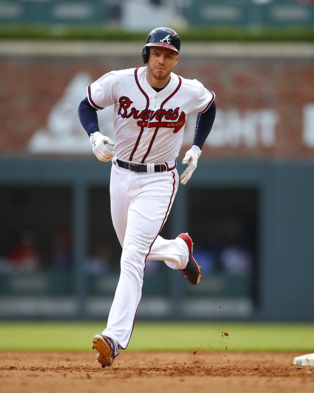 Atlanta Braves' Freddie Freeman rounds second after hitting a solo home run in the eighth inning of a baseball game against the New York Mets, Wednesday, June 13, 2018, in Atlanta. (AP Photo/Todd Kirkland)