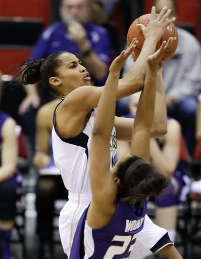 Notre Dame's Skylar Diggins, left, shoots against Kansas State's Ashia Woods during the first half of an NCAA college basketball game, Thursday, Dec. 20, 2012, in Las Vegas. (AP Photo/Julie Jacobson)