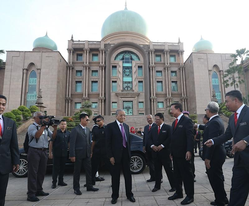 Prime Minister Tun Dr Mahathir Mohamad (centre) arrives for the monthly meeting with workers from the Prime Minister's Department in Putrajaya May 21, 2018. — Pictures by Razak Ghazali