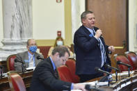 FILE - In this Dec. 7, 2020, file photo, Sen. Jason Ellsworth, R-Hamilton, speaks during a meeting of the Joint Rules Committee on the House floor of the Montana State Capitol, in Helena, Mont. As states brace for a coronavirus surge following holiday gatherings, one place stands out as a potential super-spreader site, the statehouses where lawmakers will help shape the response to the pandemic. (Thom Bridge/Independent Record via AP, File)