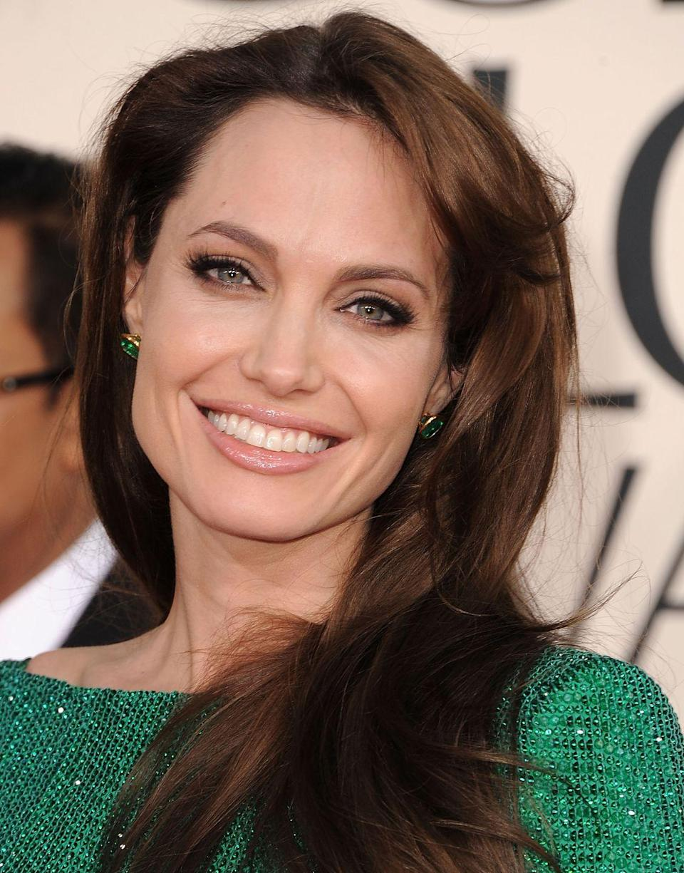 <p>Jolie's stunning eye color is highlighted because the inner and outer rings of her irises are different colors, which is called central heterochromia.</p>