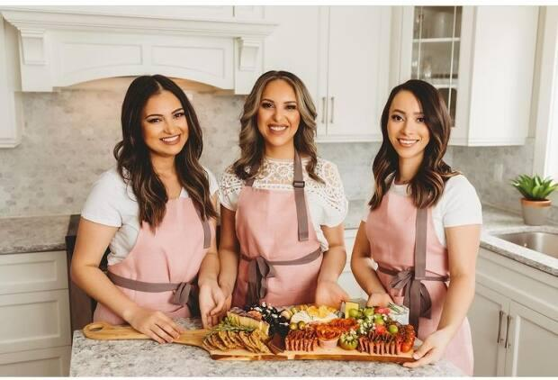 Eve Naji, left, Hajar Pittman, middle, and Kay Naji co-own Figs & Fromage in St. John's. The store opened to the public on Saturday. (Instagram/Submitted by Eve Naji - image credit)