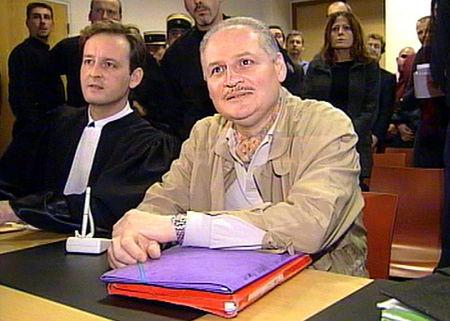 "FILE PHOTO: Ilich Ramirez Sanchez, better known as ""Carlos the Jackal"" (R) seated next to his lawyer Francis Vuillemin"