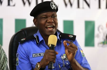 Mba, Nigeria's police force public relation officer, answers questions during a news conference in Abuja