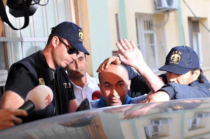 Istanbul's ex-deputy criminal police chief Kazim Aksoy (centre) has been held in detention since September 2014 (AFP Photo/Ozan Kose)