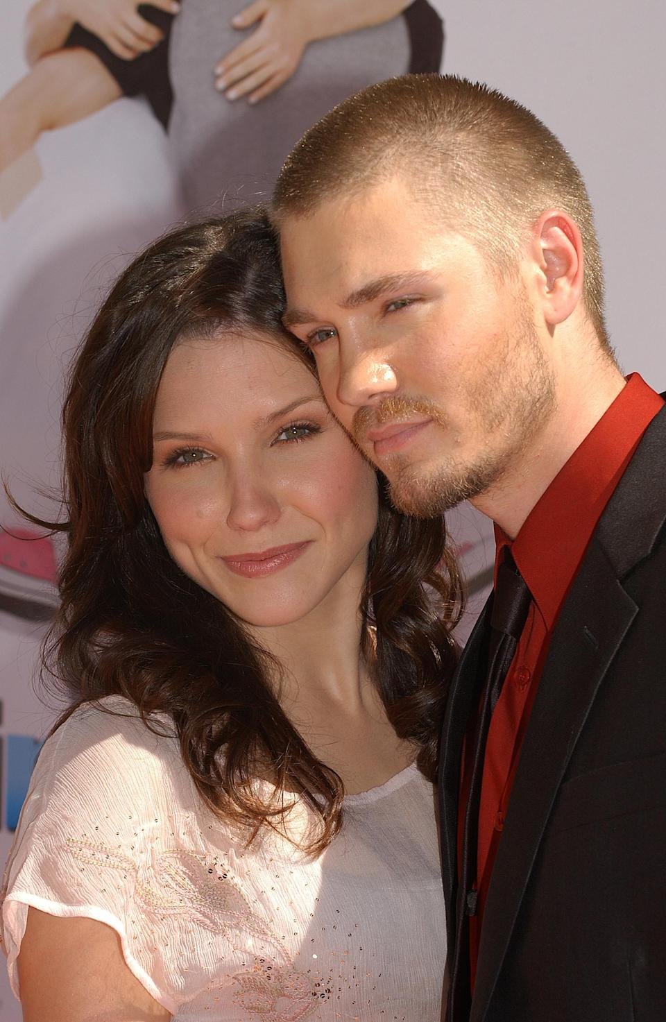 Sophia Bush and Chad Michael Murray hugging on the red carpet