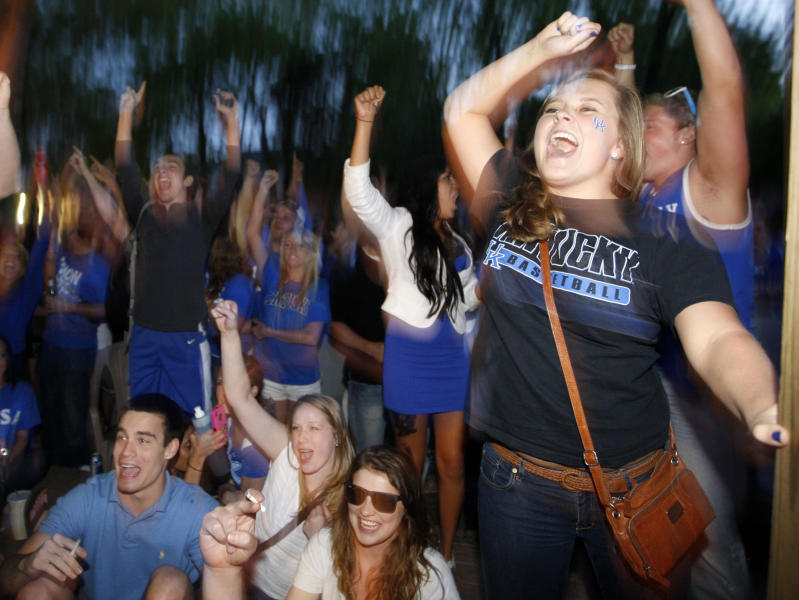 Kentucky fans celebrate Kentucky's 69-61 win over Louisville in an NCAA Final Four semifinal college basketball tournament game, Saturday, March 31, 2012, in Lexington, Ky. (AP Photo/The Courier-Journal, Amy Wallot) NO SALES; MAGS OUT; NO ARCHIVE; MANDATORY CREDIT
