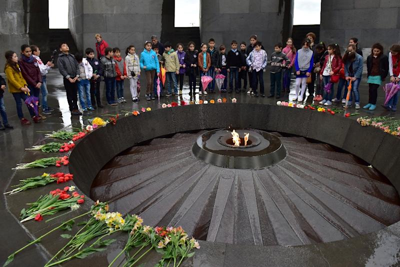 Children visit the memorial in Yerevan which commemorates the 1915 mass killing of Armenians in the Ottoman Empire (AFP Photo/Karen Minasyan)
