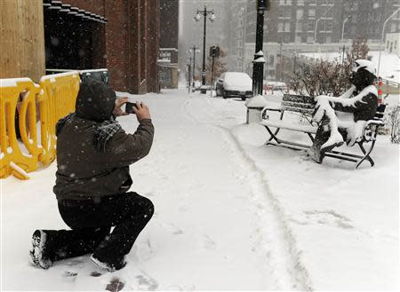 Damroze braved the blizzard to photograph a snow-covered sculpture of Mark Twain sitting on a park bench during a heavy snowstorm that covered the metro area in downtown Kansas City