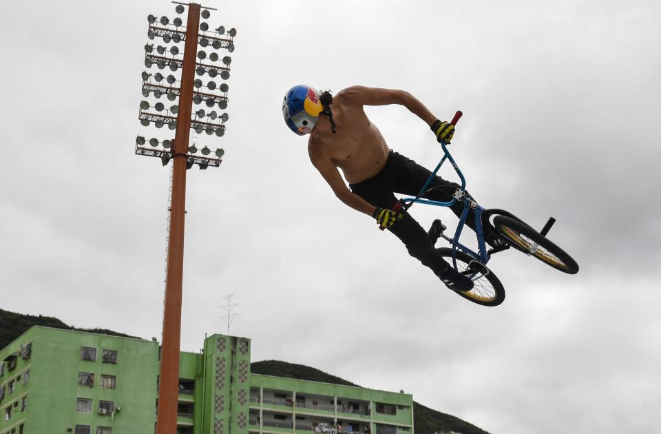 Venezuelan cyclist Daniel Dhers jumps with his bike on a ramp during a training session at the National Sports Institute in Caracas, on January 17, 2020. - Daniel Dhers, winner of several medals in different BMX Free Style championships, visited Caracas to practice in various parts of the city as part of his preparation to participate in the Tokyo 2020 Olympic Games. (Photo by Yuri CORTEZ / AFP) (Photo by YURI CORTEZ/AFP via Getty Images)