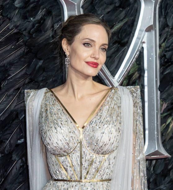 "<p>Daughter of the Oscar winning actor Jon Voight, Jolie's career took off with<em> Girl, Interrupted</em> (1999). She went on to star in many memorable roles including <a href=""https://www.amazon.com/Lara-Croft-Raider-Angelina-Jolie/dp/B000HZGBLA/ref=sr_1_1?tag=syn-yahoo-20&ascsubtag=%5Bartid%7C10063.g.34832434%5Bsrc%7Cyahoo-us"" rel=""nofollow noopener"" target=""_blank"" data-ylk=""slk:Lara Croft: Tomb Raider"" class=""link rapid-noclick-resp""><em>Lara Croft: Tomb Raider</em></a> (2001),<em> Mr. and Mrs. Smith</em> (2005), and <a href=""https://www.amazon.com/Maleficent-Theatrical-Angelina-Jolie/dp/B00P7PBD2C/ref=sr_1_2?tag=syn-yahoo-20&ascsubtag=%5Bartid%7C10063.g.34832434%5Bsrc%7Cyahoo-us"" rel=""nofollow noopener"" target=""_blank"" data-ylk=""slk:Maleficent"" class=""link rapid-noclick-resp""><em>Maleficent </em></a>(2017). </p>"