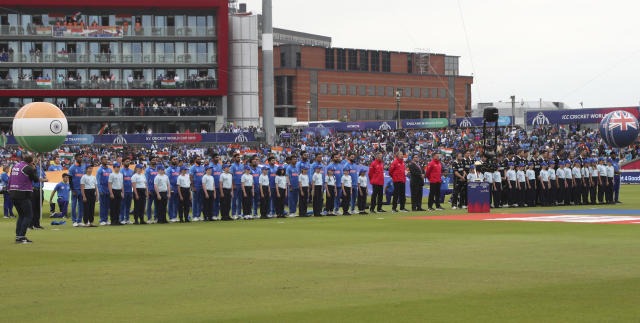 India and New Zealand players stand for their national anthems before the start of the Cricket World Cup semi-final match between India and New Zealand at Old Trafford in Manchester, England, Tuesday, July 9, 2019. (AP Photo/Aijaz Rahi)