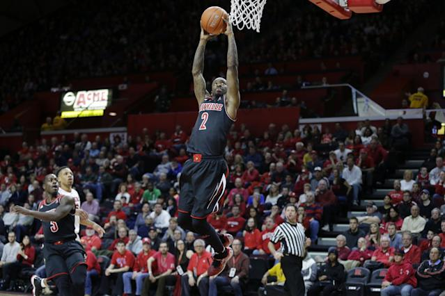 Louisville guard Russ Smith (2) dunks the ball during the first half of an NCAA college basketball game against Rutgers in Piscataway, N.J., Saturday, Jan. 4, 2014. (AP Photo/Mel Evans)