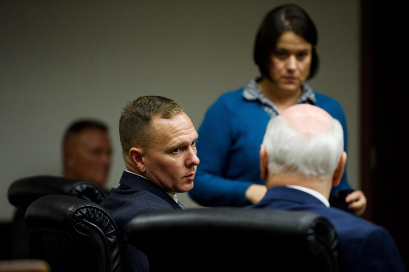 Suspended Greenville Sheriff Will Lewis speaks to his attorney, Rauch Wise, before court resumes on Thursday afternoon, Oct. 24, 2019, in Greenville, S.C. Lewis, 43, said he did not plan to have sex with his young female assistant at an out-of-town budget conference, but one thing led to another after they went out for drinks and ended up in her hotel room.(Josh Morgan/The Greenville News via AP, Pool)