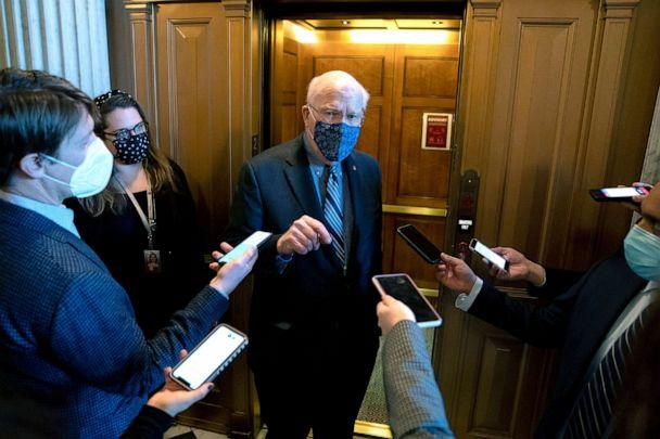 PHOTO: Sen. Patrick Leahy (D-VT) wears a protective mask while speaking to reporters at the Capitol, Jan. 12, 2021. (Stefani Reynolds/Getty Images)