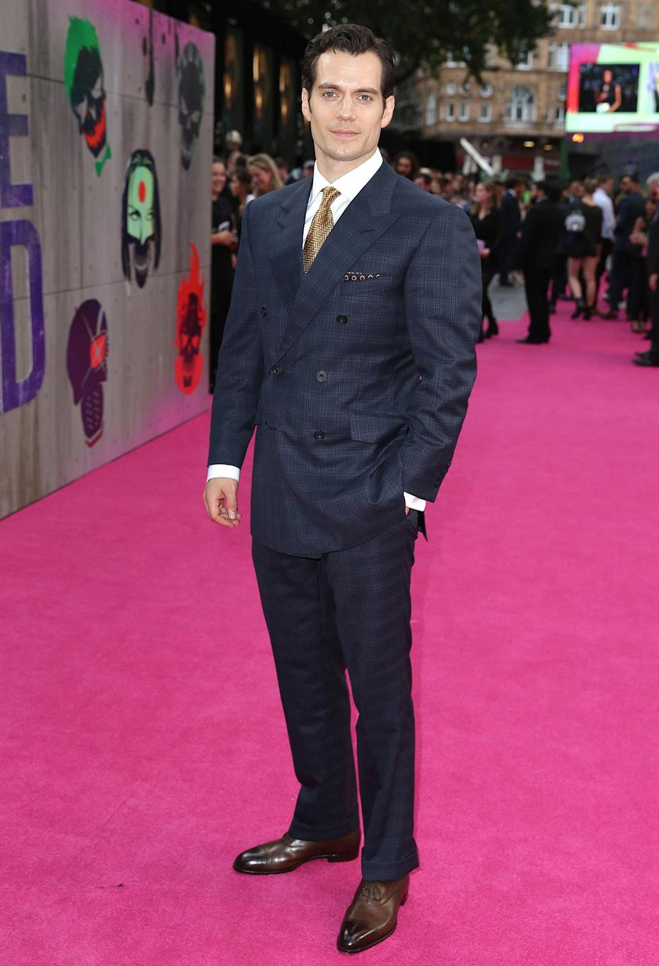 <p>Henry Cavill rocked up in a double-breasted navy suit.</p><p><br></p>