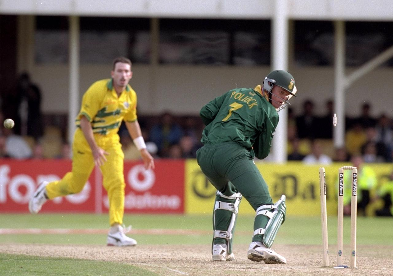 17 Jun 1999:  Shaun Pollock of South Africa is bowled by Damien Fleming of Australia in the World Cup semi-final at Edgbaston in Birmingham, England. The match finished a tie as Australia went through after finishing higher in the Super Six table. \ Mandatory Credit: Clive Mason /Allsport