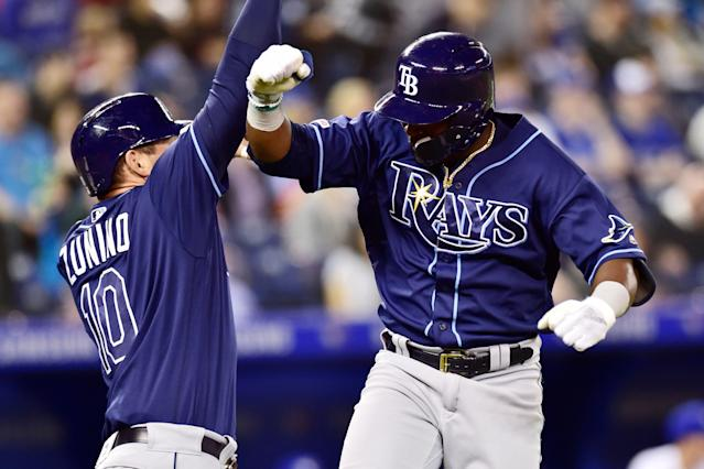 Tampa Bay Rays' Guillermo Heredia (R) celebrates his solo home run with Mike Zunino during a game against the Toronto Blue Jays in Toronto on Sunday, April 14, 2019. (AP)