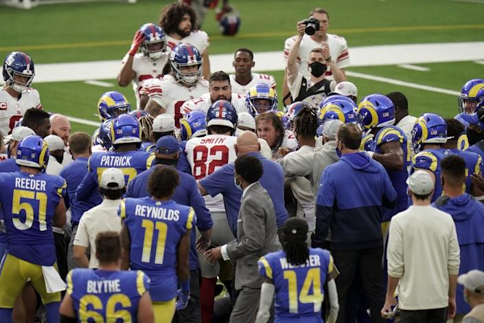 Players from the New York Giants and Los Angeles Rams scuffle at the end of an NFL football game Sunday, Oct. 4, 2020, in Inglewood, Calif. (AP Photo/Jae C. Hong )