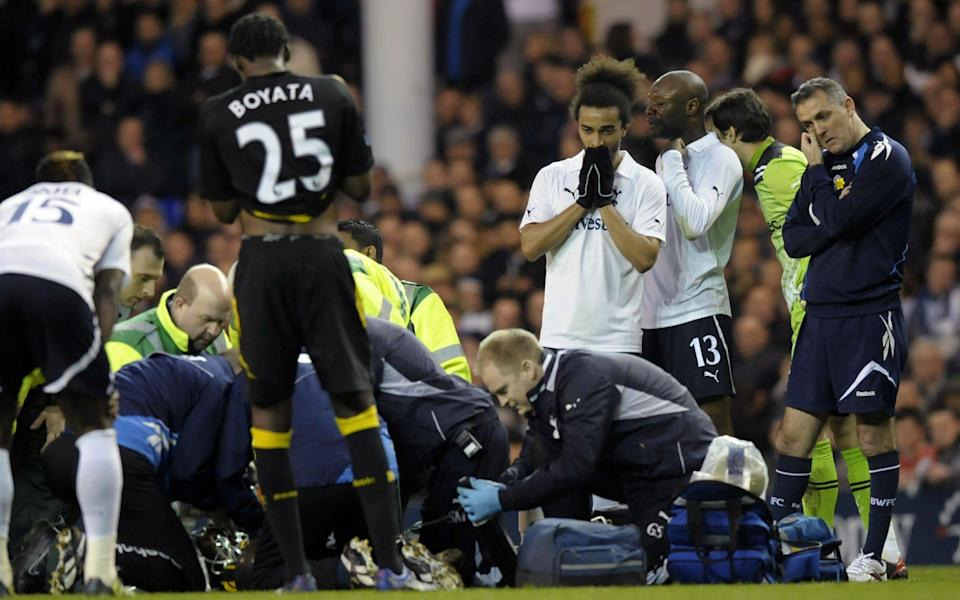 Fabrice Muamba is treated by medical staff in 2012 - he had been screened - AFP