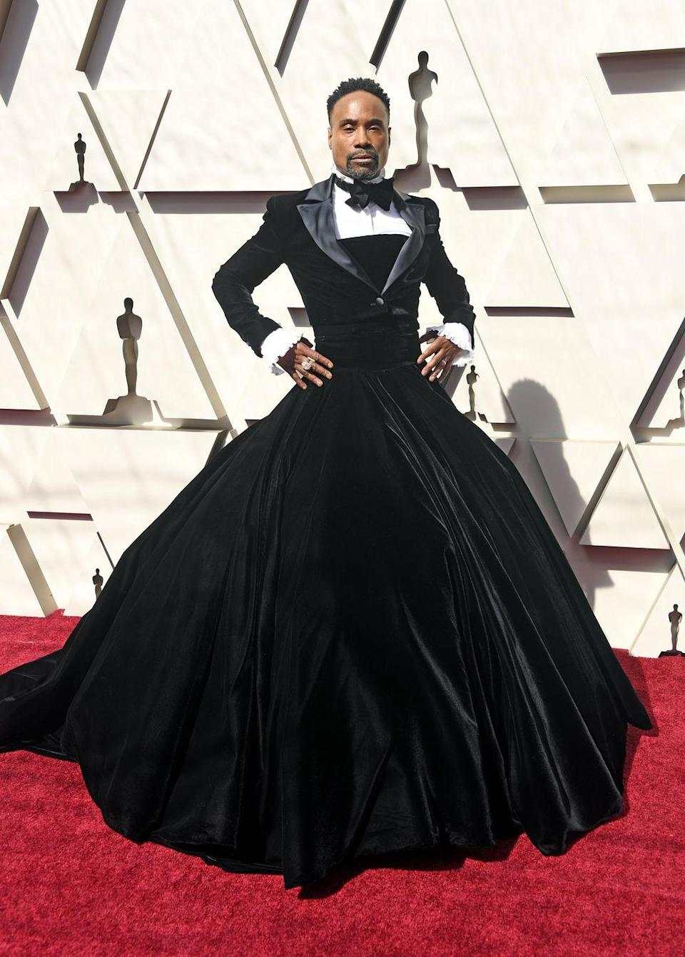 """<p>This was the moment Billy Porter 'won' the Oscars red carpet. </p><p>Wearing a black velvet Christian Siriano ballgown and matching tuxedo jacket, he described his outfit as <a href=""""https://www.elle.com/culture/movies-tv/a26500852/billy-porter-christian-siriano-oscars-2019-red-carpet/"""" rel=""""nofollow noopener"""" target=""""_blank"""" data-ylk=""""slk:'political art'."""" class=""""link rapid-noclick-resp"""">'political art'.</a><br></p><p>Porter later shared a photo of the dress on <a href=""""https://www.instagram.com/p/BuSF3dEl_e0/"""" rel=""""nofollow noopener"""" target=""""_blank"""" data-ylk=""""slk:Instagram"""" class=""""link rapid-noclick-resp"""">Instagram</a> and wrote: 'When you come to the Oscars, you must dress up. Thanks @csiriano for creating this custom couture masterpiece. @oscarheyman you have outdone yourselves once again with your iconic jewels.'</p>"""