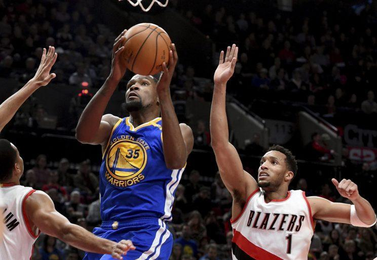 Kevin Durant's possible long-term presence means the Warriors will have to be frugal in rounding out their roster. (AP)