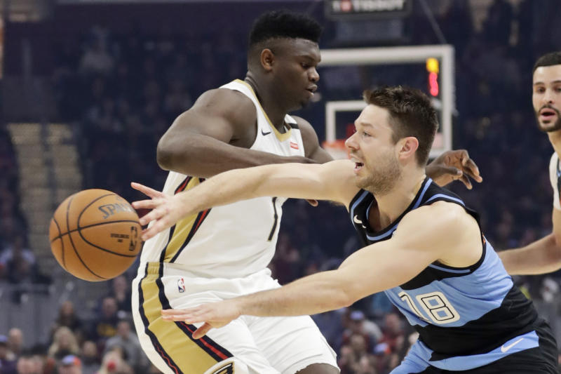 Cleveland Cavaliers' Matthew Dellavedova (18) passes the ball past New Orleans Pelicans' Zion Williamson (1) during the first half of an NBA basketball game Tuesday, Jan. 28, 2020, in Cleveland. (AP Photo/Tony Dejak)