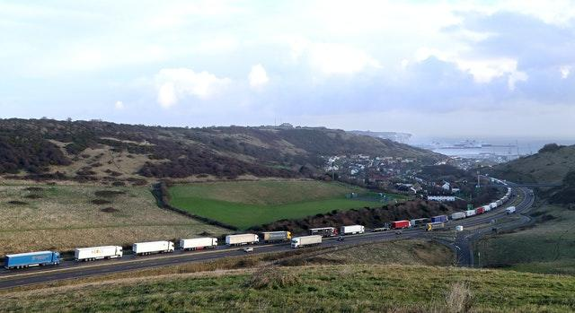 Lorries queue for The Port of Dover along the A20 in Kent