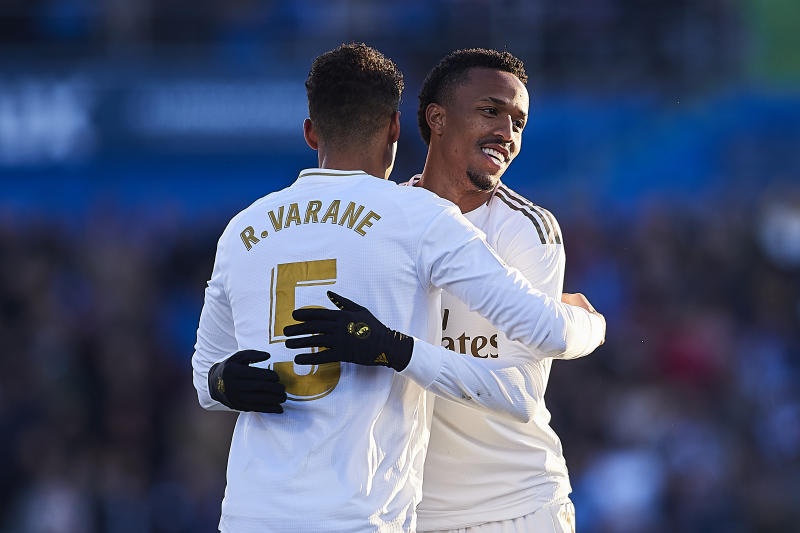 GETAFE, SPAIN - JANUARY 04: Raphael Varane of Real Madrid CF celebrates scoring his team's second goal with Eder Militao during the Liga match between Getafe CF and Real Madrid CF at Coliseum Alfonso Perez on January 04, 2020 in Getafe, Spain. (Photo by Quality Sport Images/Getty Images)
