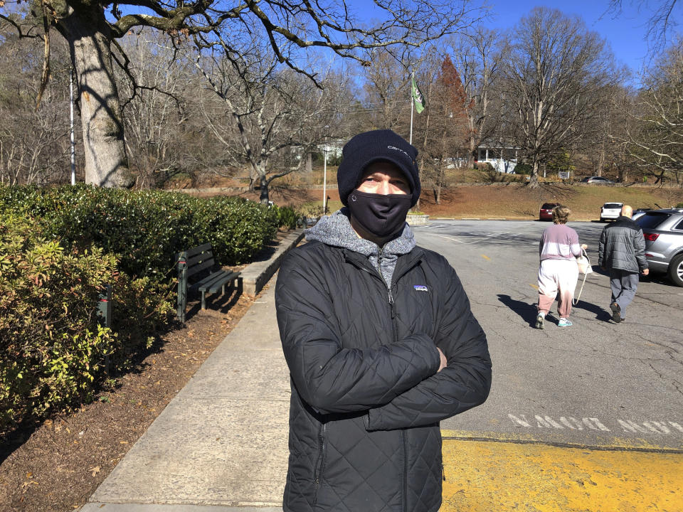 Lee Kneer talks about his votes for Democrats Jon Ossoff and Raphael Warnock at Chastain Park in Atlanta on Saturday, Dec. 26, 2020. Many voters in this area of Atlanta voted for Democrat Joe Biden but also cast votes for Republican Senate candidates. (AP Photo/Jeff Amy)