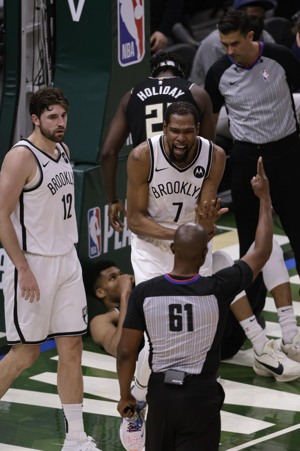 Brooklyn Nets forward Kevin Durant (7) argues a call against him during the second half of Game 6 of the team's second-round NBA basketball playoff series against the Milwaukee Bucks on Thursday, June 17, 2021, in Milwaukee. (AP Photo/Jeffrey Phelps)