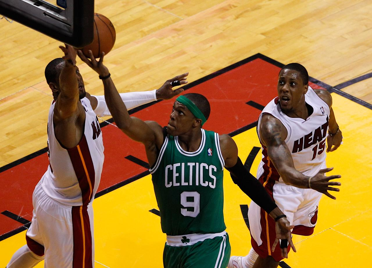 MIAMI, FL - JUNE 09:  Rajon Rondo #9 of the Boston Celtics goes up for a shot between Dwyane Wade #3 and Mario Chalmers #15 of the Miami Heat in the first half in Game Seven of the Eastern Conference Finals in the 2012 NBA Playoffs on June 9, 2012 at American Airlines Arena in Miami, Florida. NOTE TO USER: User expressly acknowledges and agrees that, by downloading and or using this photograph, User is consenting to the terms and conditions of the Getty Images License Agreement.  (Photo by J. Meric/Getty Images)