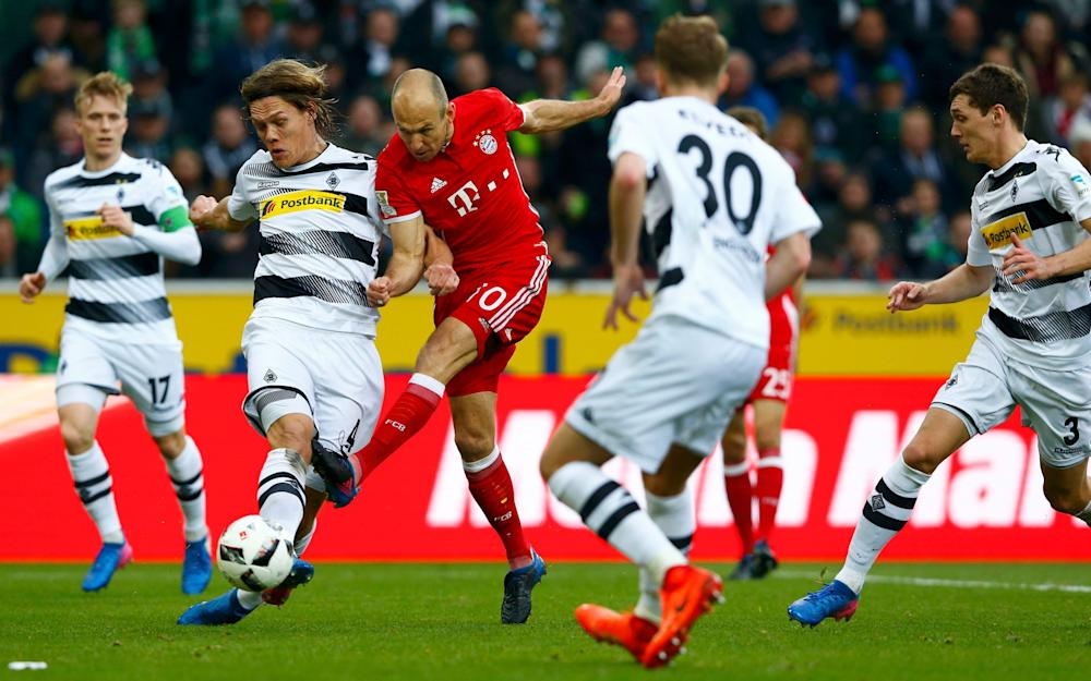 Football Soccer - Borussia Moenchengladbach v Bayern Munich - German Bundesliga - Stadion im Borussia Park, Moenchengladbach, Germany - 19/3/17 - Borussia Moenchengladbach's Jannik Vestergaard and Bayern Munich's Arjen Robben in action. REUTERS/Thilo Schmuelgen DFL RULES TO LIMIT THE ONLINE USAGE DURING MATCH TIME TO 15 PICTURES PER GAME. IMAGE SEQUENCES TO SIMULATE VIDEO IS NOT ALLOWED AT ANY TIME. FOR FURTHER QUERIES PLEASE CONTACT DFL DIRECTLY AT + 49 69 650050. Image title: Football Soccer - Borussia Moenchengladbach v Bayern Munich - German Bundesliga - Credit: Thilo Schmuelgen/REUTERS