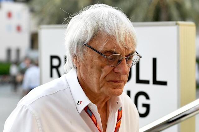 Former Formula One boss Bernie Ecclestone looks on in the paddock ahead of the Formula One Bahrain Grand Prix at the Sakhir circuit in the desert south of the Bahrain's capital, Manama, on April 14, 2017 (AFP Photo/ANDREJ ISAKOVIC)