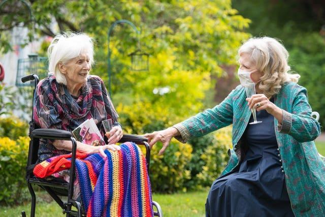 Judith du Vivier visits her 100-year-old mother Urania Brett for a surprise birthday party at the Compton Lodge care home in Camden in July