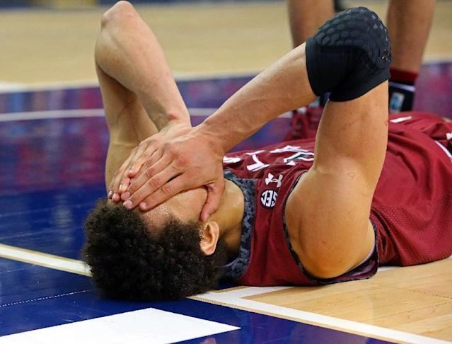 South Carolina forward Michael Carrera reacts on the floor after a play in the second half of an NCAA college basketball game against Tennessee in the quarterfinal round of the Southeastern Conference tournament on Friday, March 14, 2014, in Atlanta. (AP Photo/Atlanta Journal-Constitution, Curtis Compton)