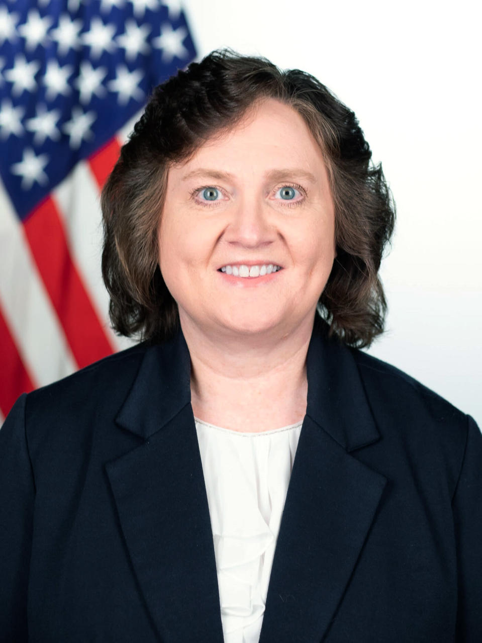 This photo provided by The White House shows Lynne Parker. The computer scientist made breakthroughs in getting robots to work together so they could perform difficult missions, like cleaning up after a nuclear disaster, waxing floors or pulling barnacles off a ship. Her job now is getting the U.S. government working together — alongside American businesses, research universities and international allies — as director of a new national initiative on artificial intelligence. (Keegan Barber/The White House via AP)