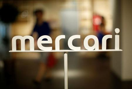 The logo of Mercari is displayed at the company's Tokyo headquarters in Tokyo, Japan, June 15, 2018.  REUTERS/Issei Kato