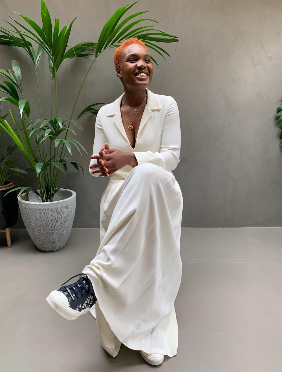 "<h2>Arlo Parks, Dior</h2><br>""Hurt"" singer Arlo Parks looked much more relaxed while watching the Dior show from home than she probably would've been running from show to show in Paris. For the virtual occasion, she paired an ivory-colored, collared maxi dress with Dior logo sneakers."