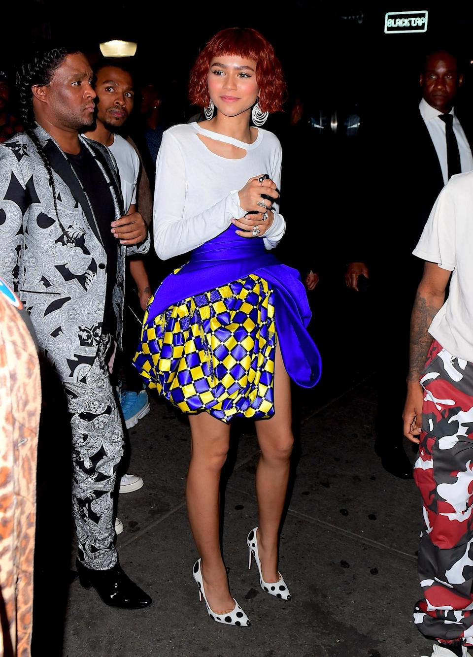 <p>Zendaya, who debuted a dramatic new hairstyle, put on a bubbly polka-dot look to party the night away. (Photo: Splash News) </p>