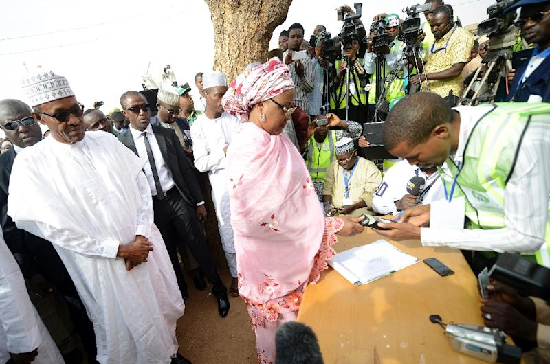Aisha Buhari (C) registers to vote on March 28, 2015 in Daura, Nigeria (AFP Photo/Pius Utomi Ekpei)