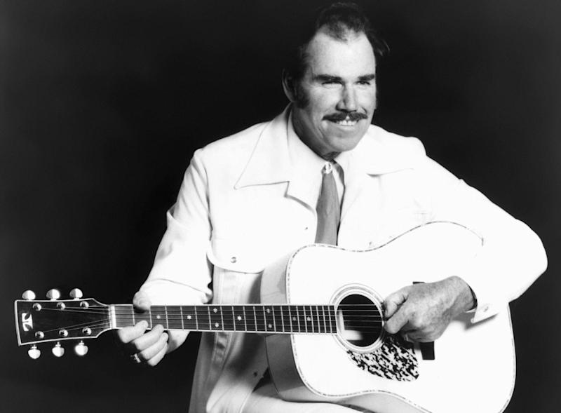 CORRECTS DATE OF DEATH TO JUNE 19 - FILE - This undated file photo shows country singer Slim Whitman. Whitman died Wednesday, June 19, 2013 of heart failure in Florida. He was 90. Whitman's career began in the late 1940s, and his tenor falsetto and ebony mustache and sideburns became global trademarks. They were also an inspiration for countless jokes thanks to the ubiquitous 1980s and 1990s TV commercials that pitched his records. (AP Photo, file)