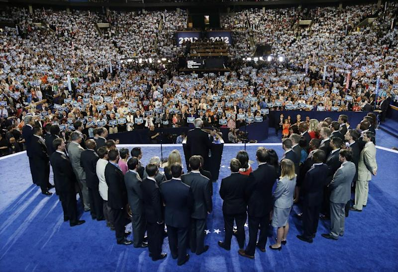 Ret. Navy Admiral John B. Nathman, surrounded by members of the armed forces, speaks to delegates at the Democratic National Convention in Charlotte, N.C., on Thursday, Sept. 6, 2012. (AP Photo/Charlie Neibergall)
